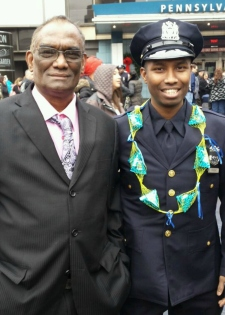 R. with his father at his NYPD Academy graduation.